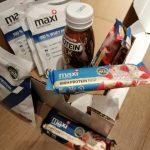 Test outdoor des produits Maxi Nutrition : des copléments alimentaires sains (préparation pour boisson, barres céréales et lait protéliné).